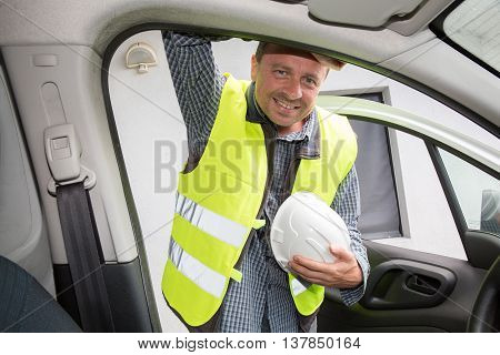 Man Builder With White Helmet At Construction Site