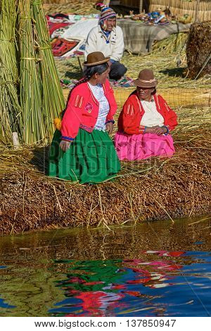 UROS PERU - JULY 29 2012: Family Living at Floating Islands of Uros at Lake Titicaca in Peru and Bolivia