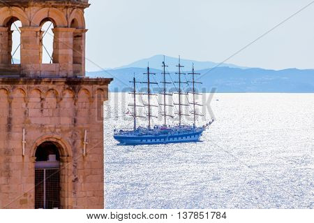 The old town Dubrovnik on the Adriatic Sea background with old ship. Travel to Croatia. Blue hours.
