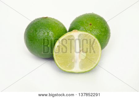 Lemon Or Lime Fruit With Half Cross Section Isolated On White