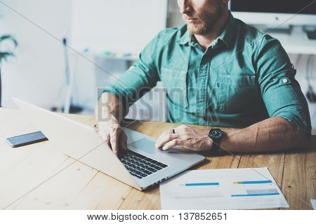Department Analyst Working Wood Table Laptop Modern Interior Design Loft Place.Businessman Work Coworking Studio.Use Contemporary Notebook, typing keyboard.Blurred Background.Creative Business Startup
