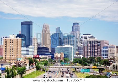 MINNEAPOLIS MN USA - JUNE 30 2016: Downtown Minneapolis Minnesota Skyline on a Sunny Morning