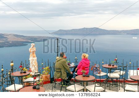 Fira, Greece - May 1, 2016: Embankment in the town of Fira on the island of Santorini. The Greek islands are one of the most visited tourist destinations in Europe.