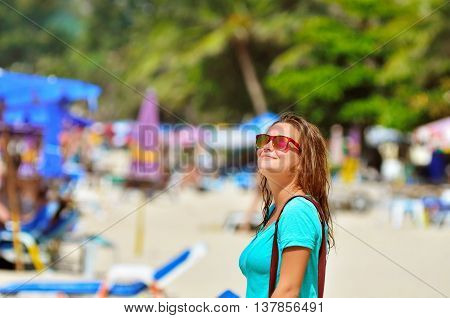 Portrait of beautiful young woman at the beach. Vacation in Thaiand.