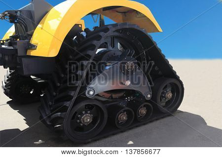 rubber crampons on a tractor for construction work and agriculture