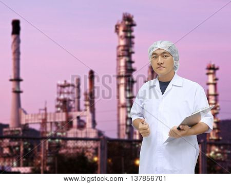A man in white great coat uniform and Oil refinery of background for Concept design Quality Inspection Business.