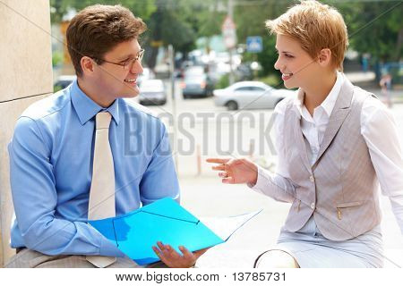 Image of two business partners interacting and planning work