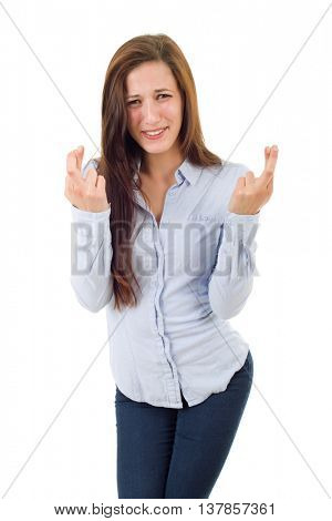 young woman with crossed fingers, isolated over a white background