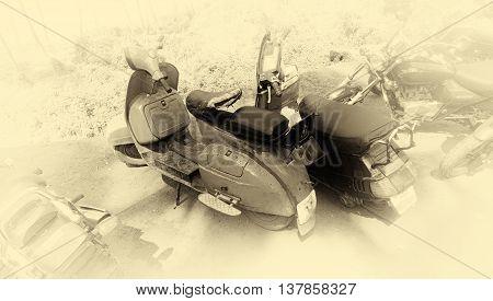Horizontal vintage sepia indian motor scooter vignette background backdrop