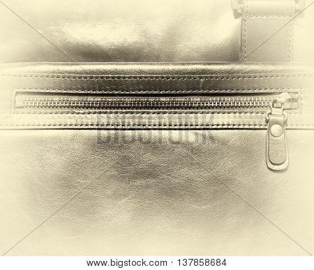 Horizontal vintage leather case with zipper vignette background