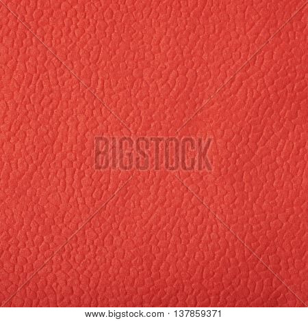 Texture of a red paper napkin as a backdrop composition