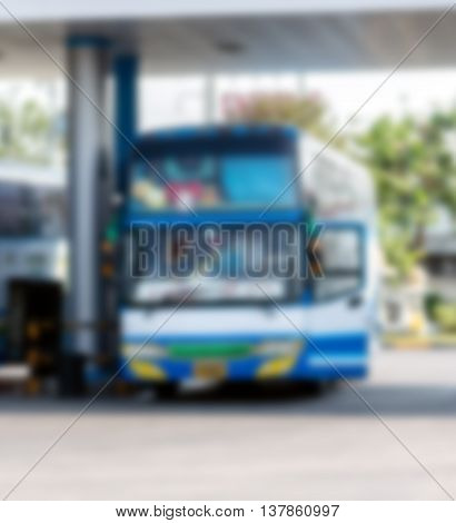 Blurred gas station with bus with copy space