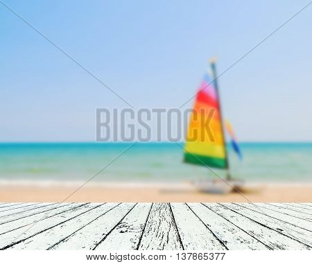 Image of blurred sea blue-sky and yacht boat colorful with coconut wooden plank under image