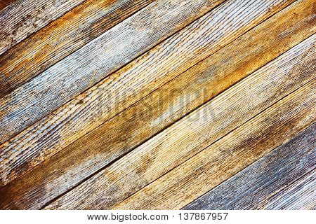 background texture old gray barn board with diagonal wooden slats. toned photo