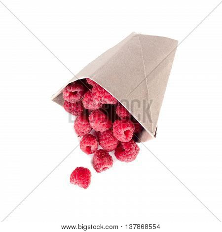 ripe raspberries scattered from a package isolated