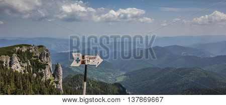 Signs at the top of ceahlau mountain range Romania