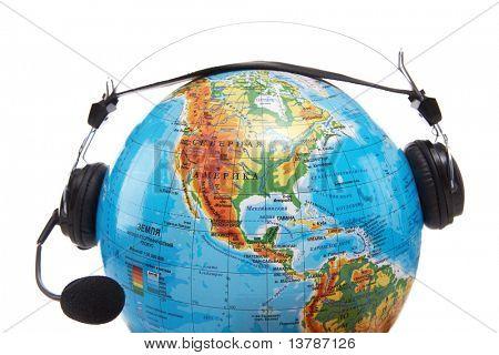 Image of globe with headset on it on white background