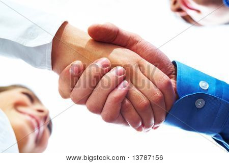 Image of partners handshake after signing contract