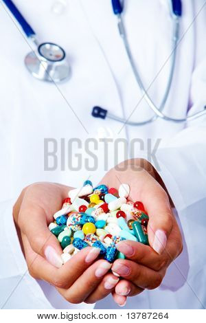 Close-up of vitamins and pills in human hands
