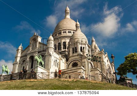 Paris France-July 09 2016: The Sacre Coeur basilica is a Roman Catholic church located at the summit of the butte Montmartre the highest point in Paris.
