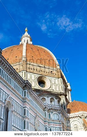 Dome of cathedral church Santa Maria del Fiore over blue sky, Florence, Italy
