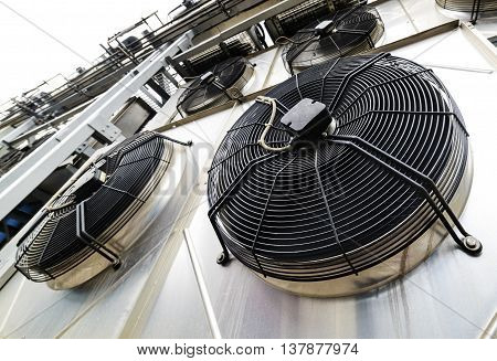 Cooling industrial air conditioning units closeup. Fans closeup.