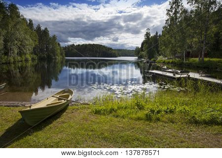 Boat on the bank of the forest lake. Finland