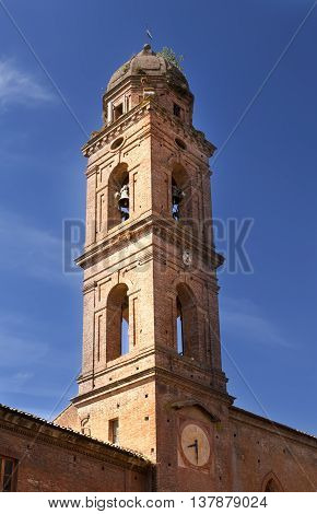 belltower on ancient building in Siena Italy