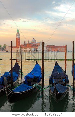 view of Gondolas and San Giorgio island at sunrise, Venice, Italy