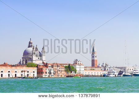famous San Marco square waterfront with Basilica Santa Maria della Salute and San Marco bell tower, Venice, Italy, retro toned