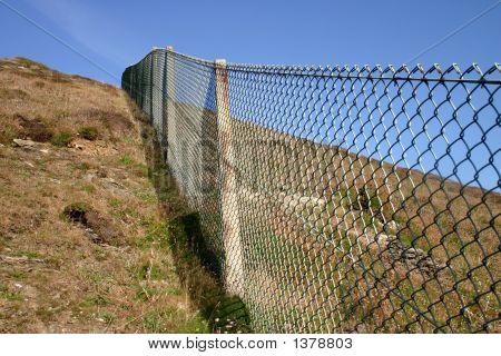 Close View Of A Ong Fence Up A Steep Hill