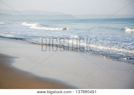 Sea beach waves and blue sky and sand