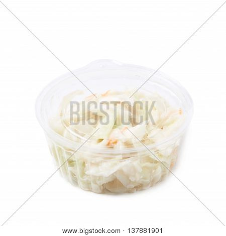 Creamy coleslaw salad in a plastic box isolated over the white background