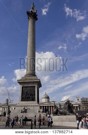 LONDON, UNITED KINGDOM - SEPTEMBER 11 2015: Nelson Statue and column in Trafalgar Square with peope around and the famous National Gallery in the background