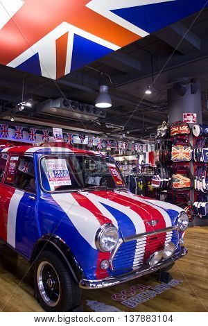 LONDON, UNITED KINGDOM - SEPTEMBER 11 2015: Mini Cooper painted with the flag of Englad in a Souvenir shop in central London