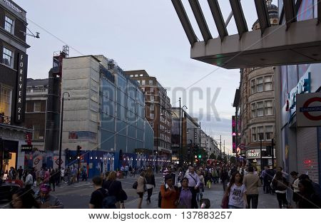 LONDON, UNITED KINGDOM - SEPTEMBER 11 2015: People around Oxford Street in London at sunset time with all London shops
