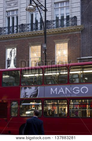 LONDON, UNITED KINGDOM - SEPTEMBER 11 2015: London red Bus with advertising by Mango in Oxford street in London