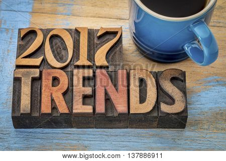 2017 trends banner - text in vintage letterpress wood type printing blocks with a cup od coffee