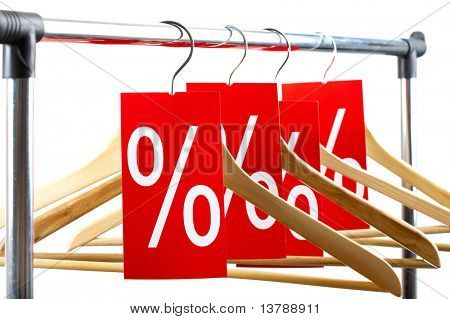 Image of several wooden hangers with red labels showing discount on them
