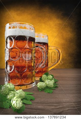 two glasses of oktoberfest beer with barley and hops on wooden table - 3D render