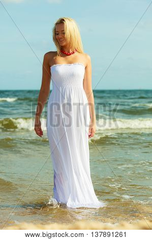 Attractive Blonde Woman On The Beach.