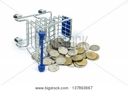 Shopping cart fell down and dropped coins on white background. Financial trouble concept.