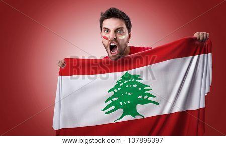 Fan holding the flag of Lebanon
