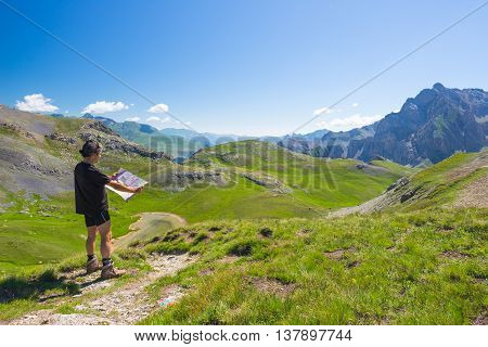 Hiker Reading Trekking Map While Resting At Panoramic Mountain Spot. Outdoors Activities, Summer Adv