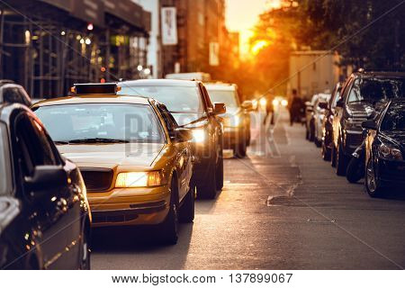 Car traffic on New York City street at sunset time