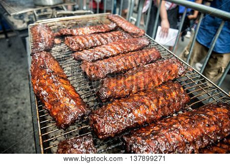 Street food city festival with BBQ on grill