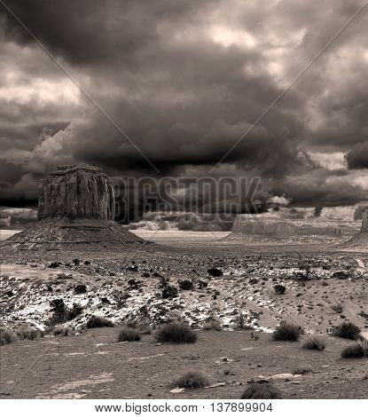 Monument Valley Arizona with stormy cloudy monochrome sepia toned