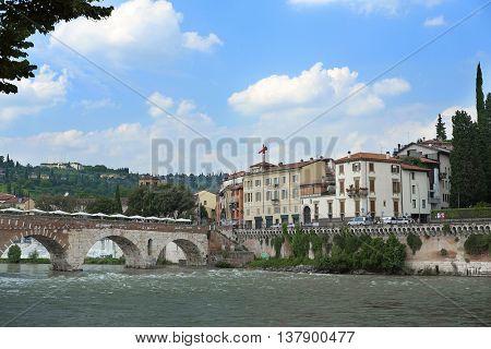 VERONA, ITALY - JULY, 2, 2016: Embankment of river Adige in Verina, Italy