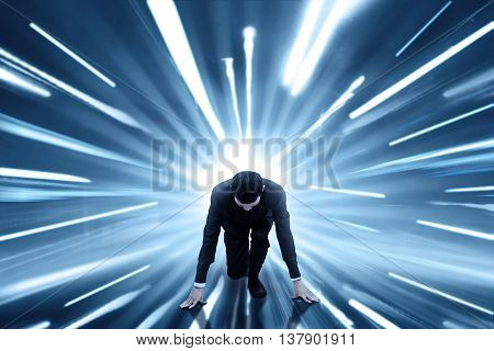 Image of male entrepreneur ready to run and compete with fast motion blur background