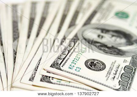 Hundred dollar bills in a fan shape